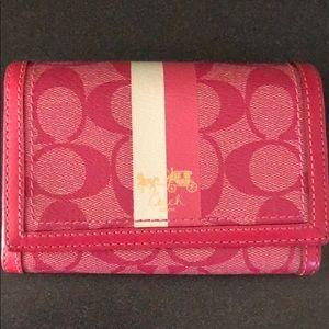 Pink Coach logo wallet